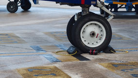 Plane wheels after Landing in Airport. Airport outdoors scene close view Stock Photos
