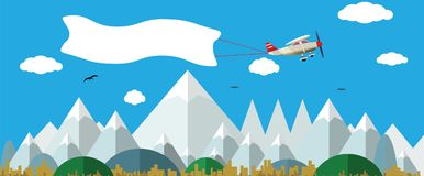 Plane with white banner flying above the nature landscape. Background for your text Stock Photography