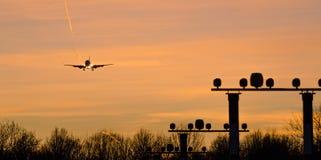 Plane will land in a orange air corridor Royalty Free Stock Photo