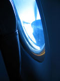 Plane window. Blue sky Stock Images