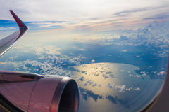 Plane window. Plane clock contrast top dusk see twenty five meters Stock Photos
