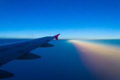 Plane window. Plane clock contrast top dusk see twenty five meters Royalty Free Stock Photo