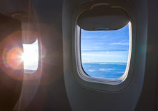 Plane window with cloud Stock Photography