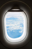 Plane window with cloud view aboard Royalty Free Stock Photos