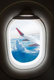 Plane window with cloud view aboard Stock Photo