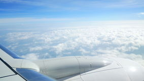 Plane window fly clouds stock footage