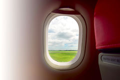 Plane window. View before take off with white space at left for text stock photography