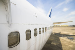 Plane windows. View of big french 747 plane tail and windows plane with blue sky background in airport Stock Photo