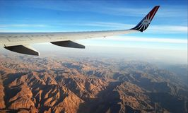 Plane wing. With lovely view in the background Stock Photos