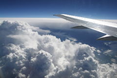 Plane Wing. Over the clouds during flight Stock Photo