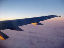 Plane wing. View from plane over the wing to blue sky Royalty Free Stock Photos