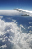 Plane Wing 2. Plane wing over the clouds during flight Royalty Free Stock Photos