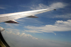 Plane in the sky. Plane wing in sky with clouds Stock Images