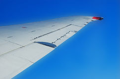 Plane wing. Clear plane wing against a deep blue sky Royalty Free Stock Images