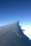 Plane wing. In a blue sky Royalty Free Stock Photography