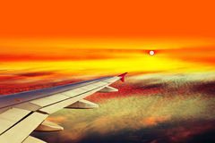 Plane wing above clouds Royalty Free Stock Image