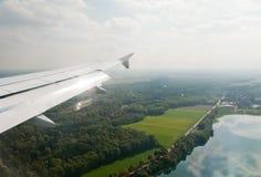 Plane wing above Franckfurt land Stock Images
