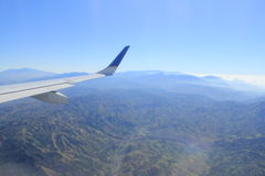 Plane wing. Above mountains in Costa Rica Royalty Free Stock Photo