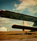 Plane wing against autumn field. Royalty Free Stock Photos