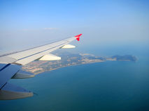 Plane wing in a blue sky above Kuala-Lumpur Royalty Free Stock Images