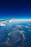 Plane wing with blue sky Stock Photo