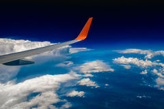 Plane Wing on Cloudscape background Stock Images