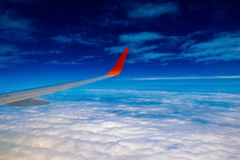 Plane Wing on Cloudscape background Royalty Free Stock Photo
