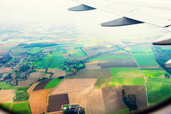 Plane wing and fields Royalty Free Stock Photos