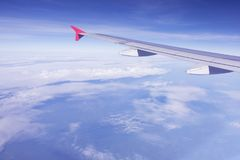 Plane wing flying over blue sky white cloud Royalty Free Stock Image