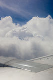 Plane wing, ground, clouds and sky Royalty Free Stock Photo
