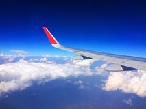 The plane wing has a beautiful sky as a background stock photo