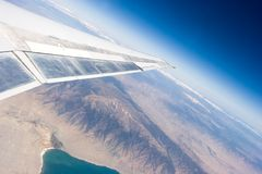 Plane wing and horizon Stock Photo