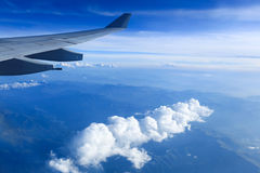 Plane wing and mountain range Royalty Free Stock Photo