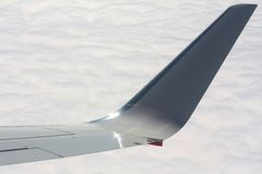 Plane wing over clouds Stock Images