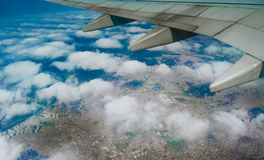 Plane wing over clouds Royalty Free Stock Photography