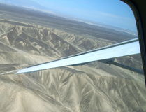 Plane wing over Nazca Lines Stock Photos