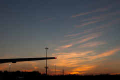 Plane wing silhouette against the sunset sky Stock Image