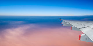 Plane wing and sky with copyspace, panoramic view Stock Photography