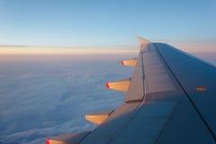 Plane wing softly illuminated by beautiful sunset Stock Images