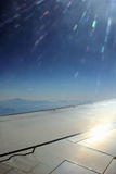 Plane wing and sun Royalty Free Stock Photo