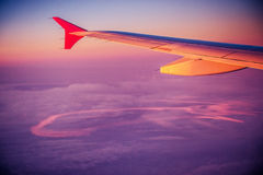 Plane wing at sunset Stock Images