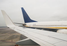 Airplane wing at the airport Stock Images