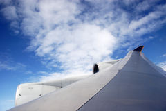 Plane wing with white clouds Stock Photo