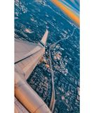 Plane wings with Seattle downtown below stock photo