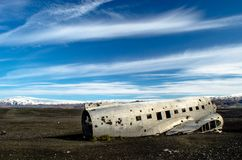 Plane wreck in Iceland. The rests of the plane are lying on the black sand in Iceland. stock photography