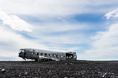 Plane wreck on Sólheimasandur black sand beach. Abandoned plane wreck on the desolate Sólheimasandur black sand beach Royalty Free Stock Image