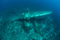 Plane Wreck From WWII Underwater. A Japanese Jake seaplane, shot down during WWII, lies on the seafloor of Palau's lagoon. Palau, in Micronesia, is known for its royalty free stock images