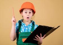 Planeamento do contramestre Arquiteto do coordenador do construtor Profissão futura Menina do construtor da criança Construa seu  foto de stock royalty free