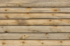 Planed wooden boards surface texture with branches background Stock Images