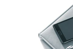 Planejador com telefone em um fundo branco isolate Imagem de Stock Royalty Free